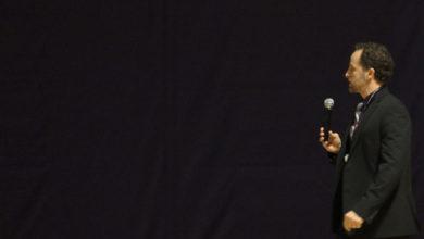 Public speaker with dark background